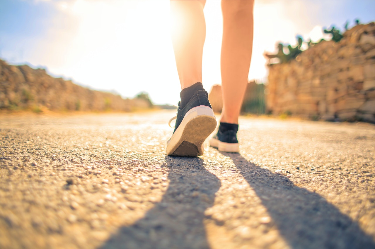 What is the difference between sneakers and walking shoes?