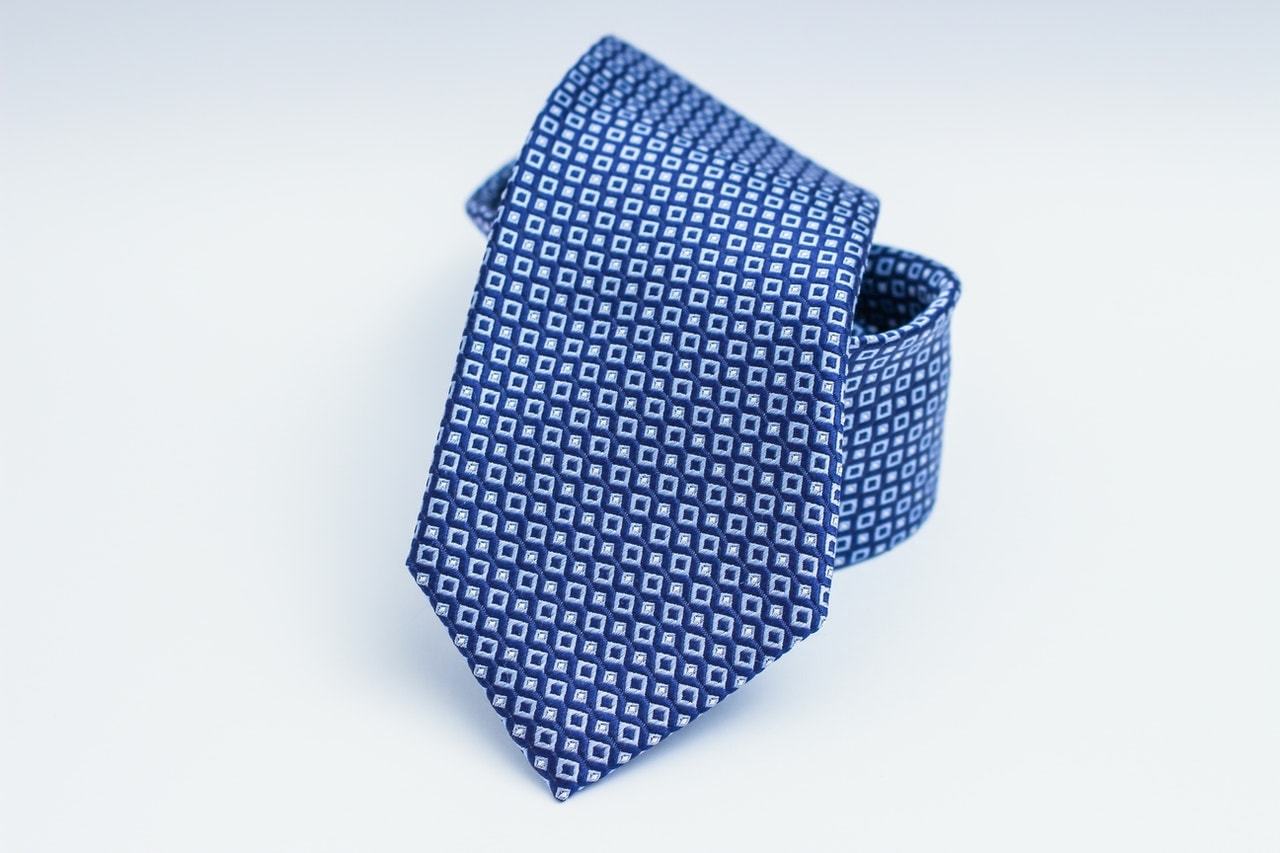 What color of a tie should you wear with a grey shirt?