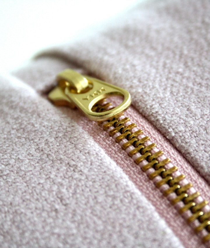 This is why sweaters have two zippers.